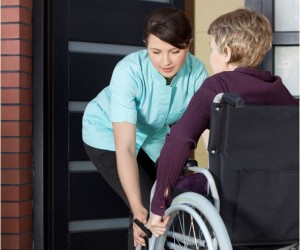 Wheelchair going into house cropped