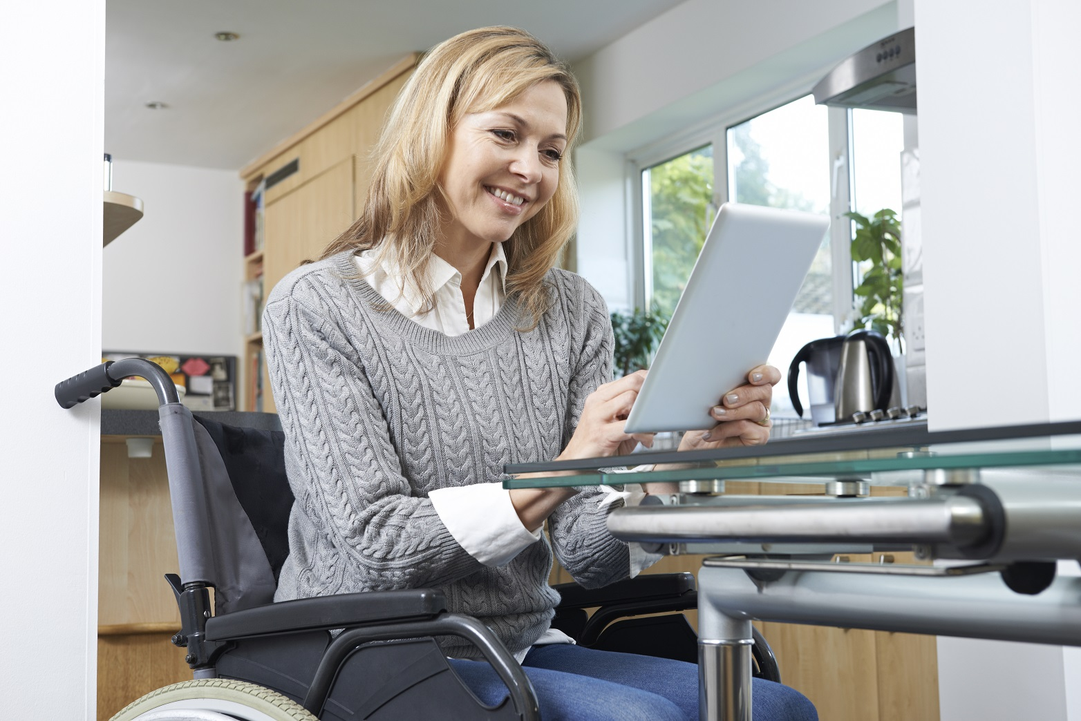 Woman At Home in Wheelchair