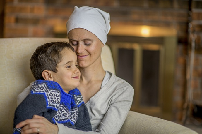 Woman With Cancer Holding Child