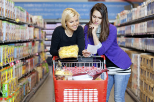 Two females grocery shopping