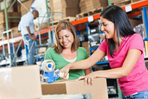 Two females working in warehouse