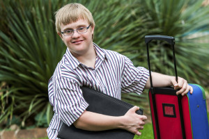 Down syndrome student with file and trolley.